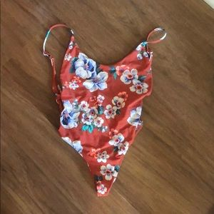 One piece swim. With cutout on the sides
